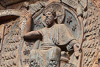 Christ enthroned as judge, gesturing towards heaven and hell, early 12th century Romanesque, carved by the Master of the Tympanum, from the tympanum of the Last Judgement above the portal on the West facade of the Abbatiale Sainte-Foy de Conques or Abbey-church of Saint-Foy, Conques, Aveyron, Midi-Pyrenees, France, a Romanesque abbey church begun 1050 under abbot Odolric to house the remains of St Foy, a 4th century female martyr. The church is on the pilgrimage route to Santiago da Compostela, and is listed as a historic monument and a UNESCO World Heritage Site. Picture by Manuel Cohen