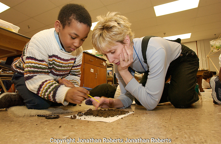 Wheatley Elementary Engineering Club student James Mitchell sifts through a soil sample.
