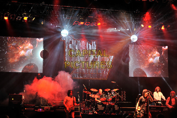 THIN LIZZY  .Performing live at the Hammersmith Apollo, London, England..January 22nd, 2011.stage concert live gig performance music half length white t-shirt guitar shirt black waistcoat singing drums keyboards .CAP/MAR.© Martin Harris/Capital Pictures.