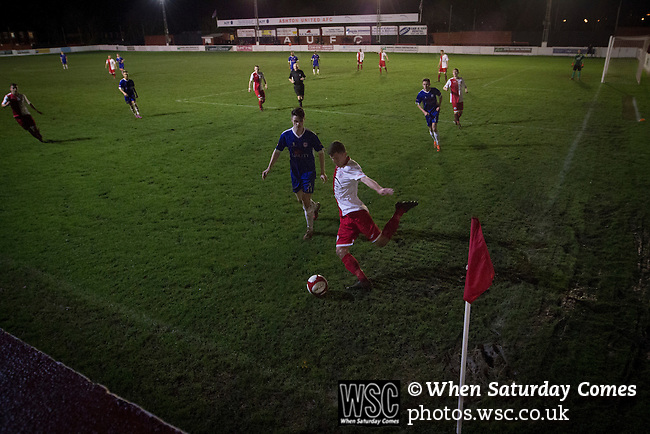 Ashton United 6 Ramsbottom United 0, 12/01/2016. Hurst Cross stadium, Northern Premier League. First-half action during the fixture between Ashton United (in red) and Ramsbottom United in the Northern Premier League premier division. The match was played at Ashton's Hurst Cross stadium, the club's ground. The club was originally founded in 1878 as Hurst F.C. and by 1880 the club were playing at Hurst Cross, their current ground which makes their home one of the oldest football grounds in the world. Ashton won the match 6-0, watched by a crowd of 178. Photo by Colin McPherson.