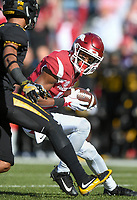NWA Democrat-Gazette/CHARLIE KAIJO Arkansas Razorbacks wide receiver Jordan Jones (10) completes a catch in the first half during a football game on Friday, November 24, 2017 at Razorback Stadium in Fayetteville.