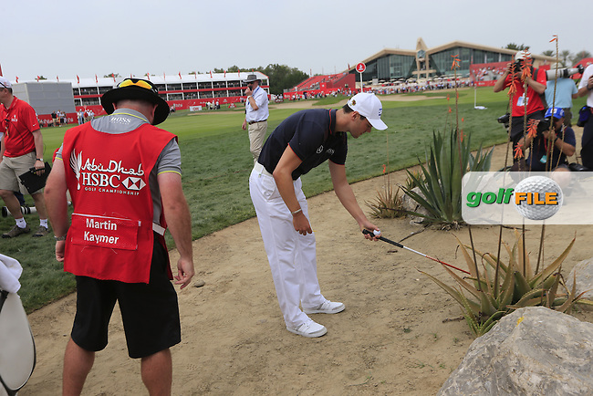 Martin Kaymer (GER) stuck behind a rock with a wayward drive on the 9th hole during Sunday's Final Round of the Abu Dhabi HSBC Golf Championship 2015 held at the Abu Dhabi Golf Course, United Arab Emirates. 18th January 2015.<br /> Picture: Eoin Clarke www.golffile.ie