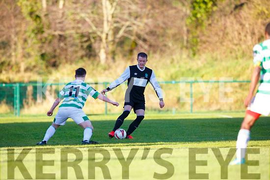 Killarney Celtic Chris O'Leary stops the Castlebar striker during their FAI clash in Killarney on Sunday