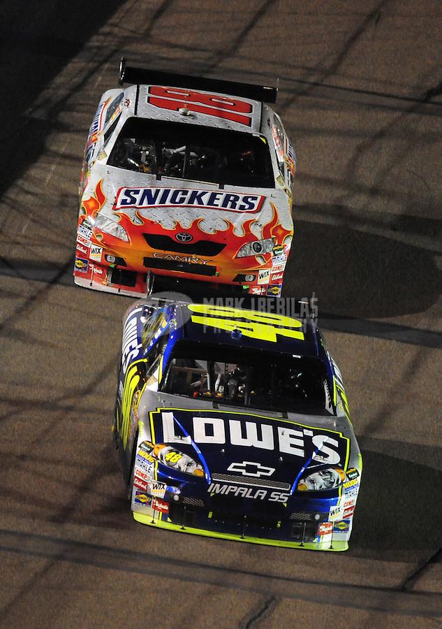 Apr 12, 2008; Avondale, AZ, USA; NASCAR Sprint Cup Series driver Jimmie Johnson (48) leads Kyle Busch (18) during the Subway Fresh Fit 500 at Phoenix International Raceway. Mandatory Credit: Mark J. Rebilas-