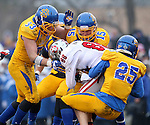 BROOKINGS, SD - NOVEMBER 22:  Brandt Van Roekel #88 from the University of South Dakota is brought down by TJ Lalley #33, Dallas Brown #15 and Jimmie Forsythe #25 from South Dakota State University in the first half of their game Saturday at Coughlin Alumni Stadium in Brookings. (Photo by Dave Eggen/Inertia)