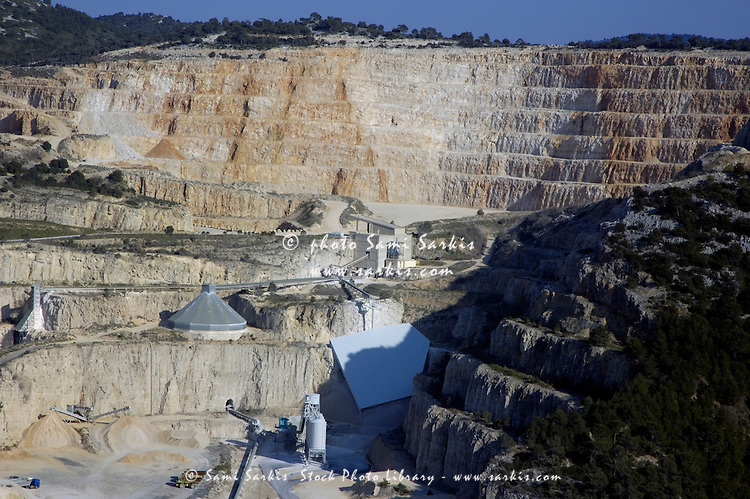 Trucks and buildings at a stone quarry, Provence, France