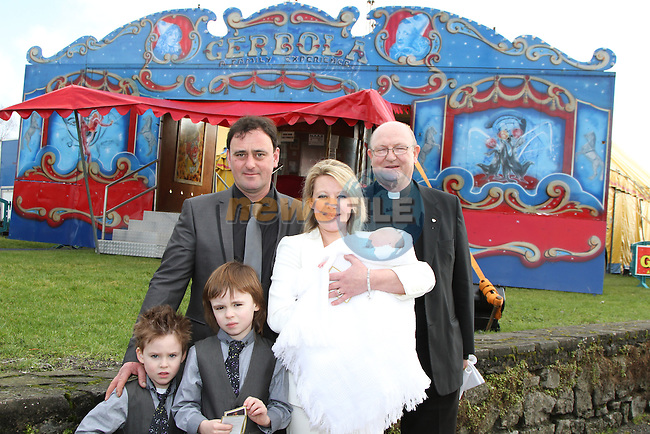 Tara and Michael  Gerbola of Circus Gerbola were due to have their baby Isabella Christened today in The Big Top in Naas.  Isabella was born on New Years Day in the back of the couples four wheel drive on the way to the hospital.  Unfortunately today they found they did not have permission to have the Christening in the tent and so Fr. Michael Ross came to the tent and performed a blessing.  Isabella is to be christened later in the day in a church.  Pictured here with Fr. Michael Ross and their other children Blake and Michael...(Photo credit should read Jenny Matthews www.newsfile.ie)....This Picture has been sent you under the conditions enclosed by:.Newsfile Ltd..The Studio,.Millmount Abbey,.Drogheda,.Co Meath..Ireland..Tel: +353(0)41-9871240.Fax: +353(0)41-9871260.GSM: +353(0)86-2500958.email: pictures@newsfile.ie.www.newsfile.ie.