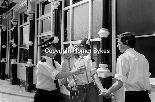 Brick Lane, Tower Hamlets east London. Police arrest a Skinhead youth supported of the NF, during a regular Sunday stand off between the Socialist Workers Party and the National Front at the north end of Brick Lane  1978<br /> <br /> My ref 10/3570/, 1978,