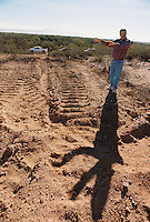 John Madsen, associate curator for the Arizona State Museum (621-4795) shows how a bulldozer from the La Oso Ranch earthmoving went off course and crossed onto BLM land and cut across a historical archaeological site...