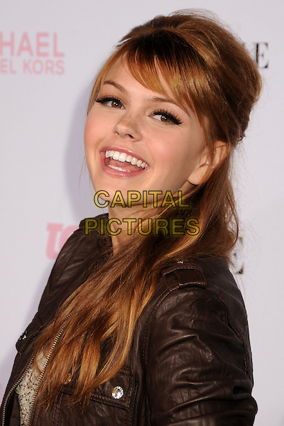 AIMEE TEEGARDEN.The 8th Annual Teen Vogue Young Hollywood Party held at Paramount Studios,  Los Angeles, California, USA, 1st October 2010..portrait headshot fringe smiling brown leather jacket .CAP/ADM/BP.©Byron Purvis/AdMedia/Capital Pictures.