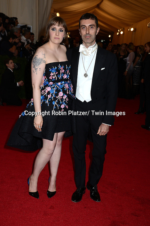 Lena Dunham and Giambattista Valli attends the Costume Institute Benefit on May 5, 2014 at the Metropolitan Museum of Art in New York City, NY, USA. The gala celebrated the opening of Charles James: Beyond Fashion and the new Anna Wintour Costume Center.