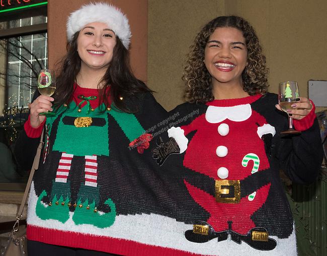 Carolina and Satara during the Ugly Sweater Wine Walk in downtown  Reno on Saturday, Dec. 16, 2017.