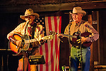 Ron Schofield and his brother, Gary play their guitars at the conclusion of the 14th season of Ron, Marie and Tom Scofield's Cowboy Campfire at his Red Mule Ranch near Fiddletown, Calif.