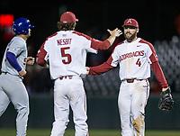 NWA Democrat-Gazette/BEN GOFF @NWABENGOFF<br /> Trevor Ezell (4), Arkansas first baseman, and Jacob Nesbit, Arkansas third baseman, celebrate after the final out to defeat LSU 14-4 Thursday, May 9, 2019, at Baum-Walker Stadium in Fayetteville.