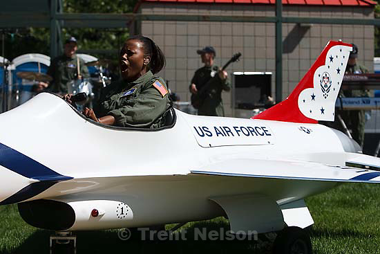 Salt Lake City - Regina Coonrod of the Air Force band Max Impact, sings from the cockpit of a model F-16 fighter during Air Force Week festivities at Pioneer Park Tuesday June 2, 2009.