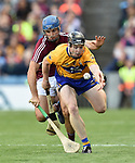 Tony Kelly of Clare in action against Johnny Coen of Galway during their All-Ireland semi-final at Croke Park. Photograph by John Kelly.