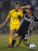 U.S. Open Cup Round of 16: DC United's Facundo Erpen (5) shields the ball from  Columbus Crew's Brandon Moss (5). DC United defeated the Columbus Crew in overtime 2-1, Tuesday, August 1, 2006, at Maryland Soccerplex.