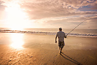 Surf fishing at the South Core Banks at sunset