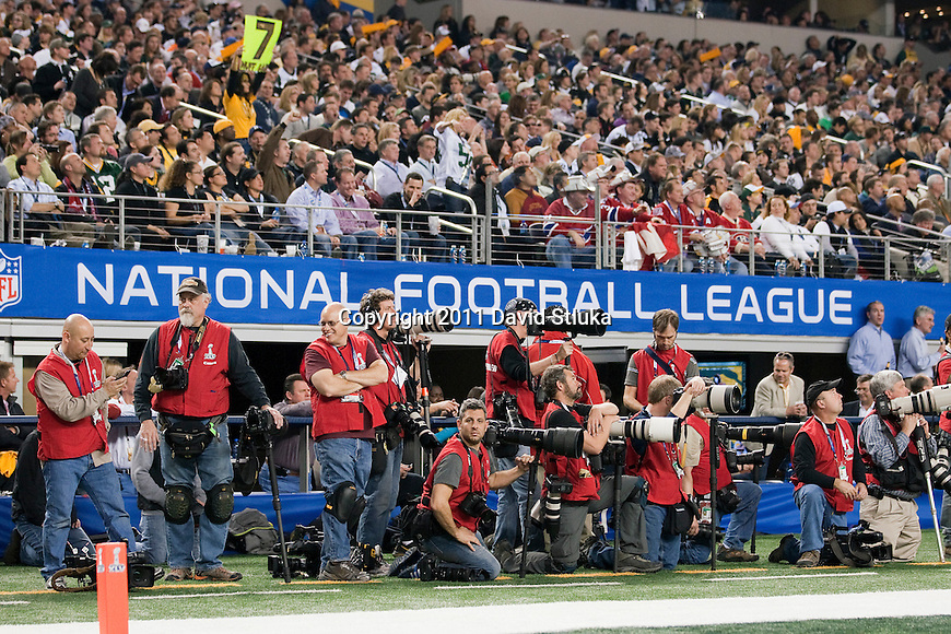 A sideline view of credentialed photographers on the sidelines of Super Bowl XLV where the Green Bay Packers played against the Pittsburgh Steelers on Sunday, February 6, 2011, in Arlington, Texas. The Packers won 31-25. (AP Photo/David Stluka)