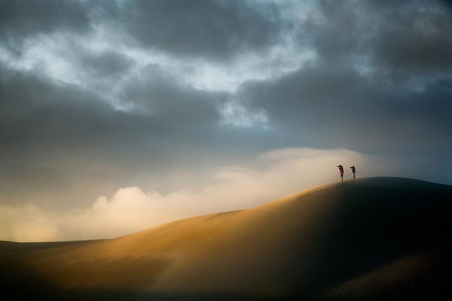 Photographers in sand dunes Australia