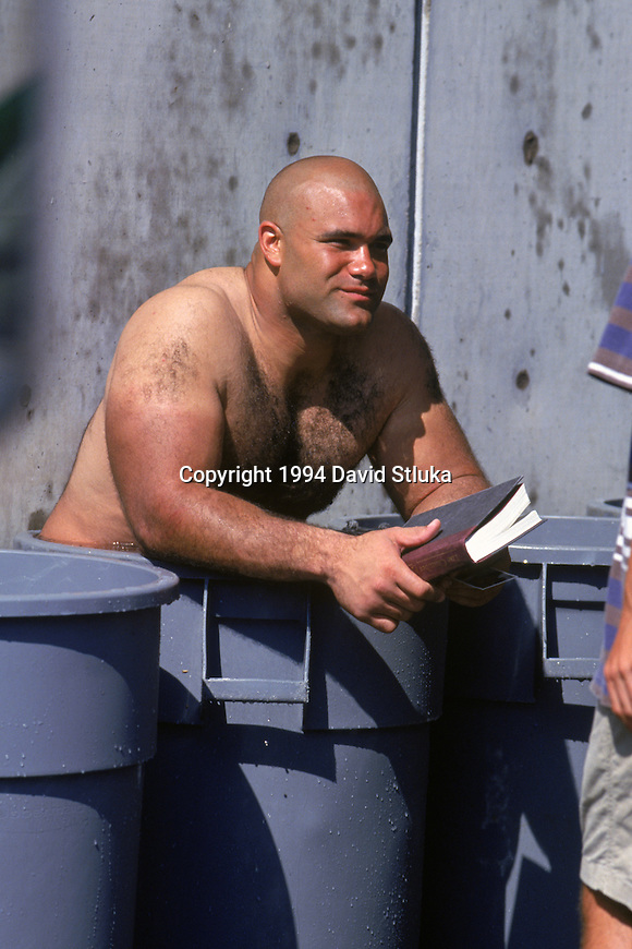 Chicago Bears defensive lineman Chris Zorich cools off in an ice bath after an NFL football practice during training camp on July 1, 1994 at University of Wisconsin in Platteville,Wisconsin. (Photo by David Stluka)