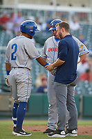 Amarillo Sod Poodles trainer Drew Garner checks on Ivan Castillo (2) as manager Phillip Wellman (30) looks on during a Texas League game against the Frisco RoughRiders on May 16, 2019 at Dr Pepper Ballpark in Frisco, Texas.  (Mike Augustin/Four Seam Images)
