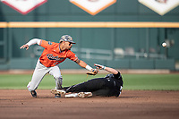 Auburn Tigers shortstop Will Holland (17) misses a throw at second during Game 4 of the NCAA College World Series against the Mississippi State Bulldogs on June 16, 2019 at TD Ameritrade Park in Omaha, Nebraska. Mississippi State defeated Auburn 5-4. (Andrew Woolley/Four Seam Images)