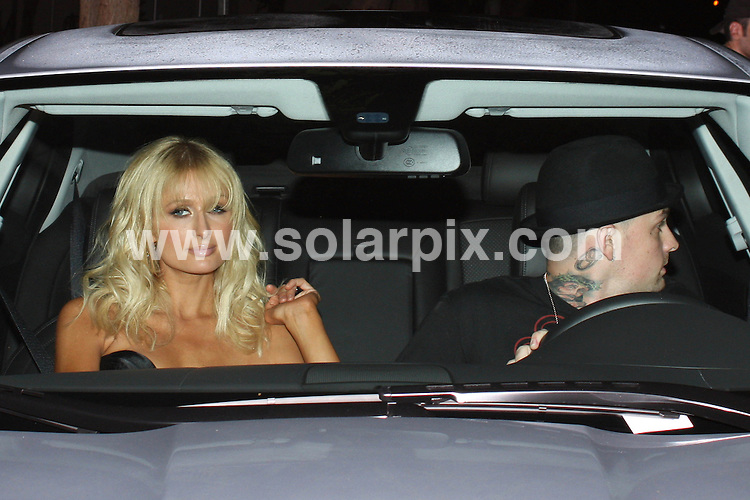 **ALL ROUND PICTURES FROM SOLARPIX.COM**.**WORLDWIDE SYNDICATION RIGHTS**.**NO PUBLICATION IN AUSTRALIA, NEW ZEALAND, DENMARK, GERMANY OR USA**.Paris Hilton and Benji Madden have a night out at The Abbey in Beverly Hills in LA USA...JOB REF: 7476            LAP/JSCW       DATE: 26.09.08.**MUST CREDIT SOLARPIX.COM OR DOUBLE FEE WILL BE CHARGED* *UNDER NO CIRCUMSTANCES IS THIS IMAGE TO BE REPRODUCED FOR ANY ONLINE EDITION WITHOUT PRIOR PERMISSION*