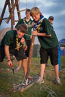 Scouts are chopping a pole / notice the Safety shoes ;-)