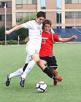 Andy Riemer #20 of Georgetown University battles for the ball with Ryan Burnham #9 of Northeastern University during an NCAA match at North Kehoe Field, Georgetown University on September 3 2010 in Washington D.C. Georgetown won 2-1 AET.