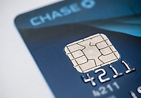 An EMV-equipped JPMorgan Chase Visa card recently received by a consumer on Monday, February 23, 2015. Card issuers American Express, Visa and MasterCard are beginning to roll out the more secure EMV chip technology in their credit cards. The new cards, used already in Europe, replace the magnetic stripe with an embedded chip using encrypted technology. (© Richard B. Levine)