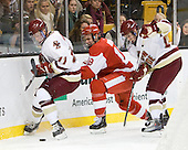 Pat Mullane (BC - 11), Wade Megan (BU - 18), Patch Alber (BC - 27) - The Boston College Eagles defeated the Boston University Terriers 3-2 (OT) in their Beanpot opener on Monday, February 7, 2011, at TD Garden in Boston, Massachusetts.