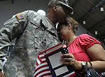 Ramonita Nieves of East Hartford, is comforted by her brother Sgt. Baranrd Sykes, both of East Hartford, during