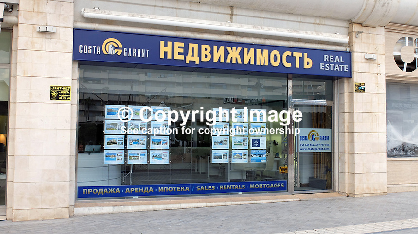 Signage in Russian on the Costa del Sol, Spain, shows its popularity with Russian ex-pats &amp; tourists. Estate agency, Puerto Banus, February, 2015, 201502060417<br /> <br /> Copyright Image from Victor Patterson, 54 Dorchester Park, Belfast, UK, BT9 6RJ<br /> <br /> t: +44 28 9066 1296<br /> m: +44 7802 353836<br /> vm +44 20 8816 7153<br /> <br /> e1: victorpatterson@me.com<br /> e2: victorpatterson@gmail.com<br /> <br /> www.victorpatterson.com<br /> <br /> IMPORTANT: Please see my Terms and Conditions of Use at www.victorpatterson.com