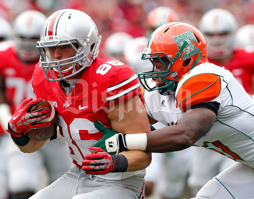 Ohio State Buckeyes tight end Jeff Heuerman (86) gets tackled by Florida A&M Rattlers linebacker Mike Ducre (51) after making a catch in the 1st quarter during their college football game at Ohio Stadium on September 21, 2013.  (Dispatch photo by Kyle Robertson)