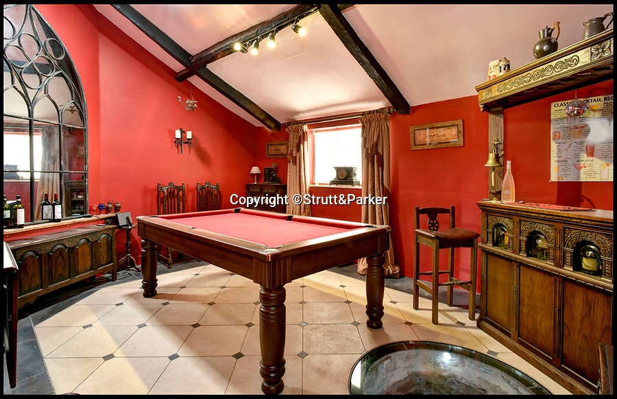 Bournemouth News (01202 558833)<br /> Pic: Strutt&Parker/BNPS<br /> <br /> Not all hard graft - the house contains a games room and bar for after the hard work is done.<br /> <br /> The ultimate Good Life is ready-made and up for grabs at a country farmhouse on the market for £850,000.<br /> <br /> Tuckerton Farm near Bridgwater, Somerset, is not only self-sufficient in fruit and vegetables, but it even has its own wine supply from a hobby vineyard in the grounds.<br /> <br /> There is also chickens, which provide a steady supply of eggs, an orchard with cider, cooking and eating apples and they offset their electricity bill by selling the electric from their solar panels back to the grid.<br /> <br /> The rundown house was in such a bad state when Barbara Pitkin, 60, and her wife Sue Frost, 52, bought it that their surveyor told them not to buy it and did not charge them for his services.