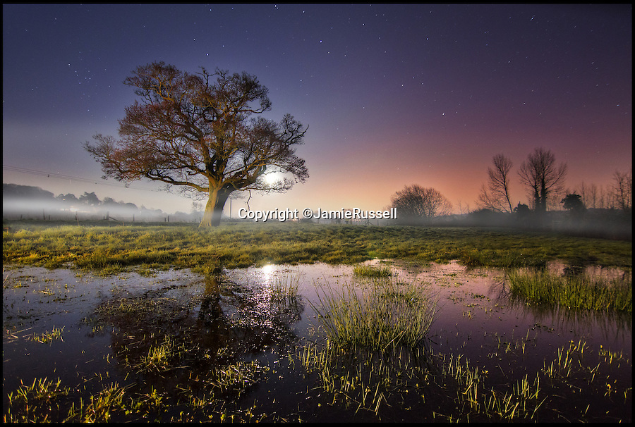 BNPS.co.uk (01202 558833)<br /> Pic: JamieRussell/BNPS<br /> <br /> ***Please Use Full Byline***<br /> <br /> The moonrise, over Alerstone flood plain. <br /> <br /> Stunning photographs have revealed a turbulent side to the normally genteel Isle of Wight.<br /> <br /> The seemingly benign south coast holiday destination has been catalogued over a stormy year by local photographer Jamie Russell, and his astonishing pictures reveal the dramatic changes in weather that roll across the UK in just 12 months.<br /> <br /> Lightning storms, ice, floods, gales and blizzards have all been captured by the intrepid photographer who frequently got up in the middle of the night to capture the climatic chaos.<br /> <br /> Looking at these pictures prospective holidaymakers could be forgiven for thinking twice about a gentle staycation on the south coast island.