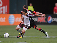 Colorado Rapids midfielder Martin Rivero (10) shields the ball against D.C. United midfielder Perry Kitchen (23) D.C. United defeated the Colorado Rapids 2-0 at RFK Stadium, Wednesday May 16, 2012.