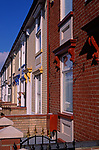A751Y8 Row of well maintained brick terraced houses freshly and brightly painted, Great Yarmouth, Norfolk, England