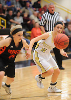 NWA Democrat-Gazette/ANDY SHUPE<br /> Kayla Kardynalski (24) of Gravette and Katie Cormier of Pottsville vie for a loose ball Wednesday, Feb. 24, 2016, during the first half of play in the 4A North Regional Tournament in Tiger Arena in Prairie Grove. Visit nwadg.com/photos to see more photographs from the game.