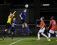 The number 24 ranked Furman Paladins took on the number 20 ranked Clemson Tigers in an inter-conference game at Clemson's Riggs Field.  Furman defeated Clemson 2-1.  Furman's Michael Gandier (18) heads the ball over Clemson goalie Andrew Tarbell (22) for Furman's second goal.