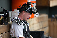 Winston-Salem Dash catcher Zack Collins (8) sits in the dugout during the game against the Myrtle Beach Pelicans at BB&T Ballpark on May 11, 2017 in Winston-Salem, North Carolina.  The Pelicans defeated the Dash 9-7.  (Brian Westerholt/Four Seam Images)