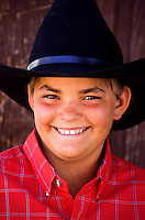 Portrait of a cowboy child with a black hat in Utah, USA