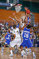 25 February 2010:  FIU's Marlon Bright (34) battles MTSU's Desmond Yates (31) and others for a rebound in the second half as the Middle Tennessee Blue Raiders defeated the FIU Golden Panthers, 74-71, at the U.S. Century Bank Arena in Miami, Florida.