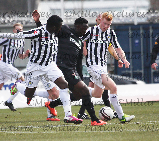 Victor Wanyama being pressured by Esmael Goncalves (left) and Conor Newton in the St Mirren v Celtic Clydesdale Bank Scottish Premier League match played at St Mirren Park, Paisley on 31.3.13.