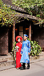Vietnamese Wedding Couple - Vietnamese wedding couple wearing traditional red and blue silk ao dais, Hoi An, Viet Nam