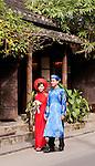 Vietnamese Wedding Couple - Vietnamese wedding couple wearing traditional red and blue silk ao dais, Hoi An, Viet Nam