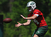 Sam Darnold #14, New York Jets quarterback, takes a snap during OTAs held at the Atlantic Health Jets Training Center in Florham Park, NJ on Tuesday, May 29, 2018.