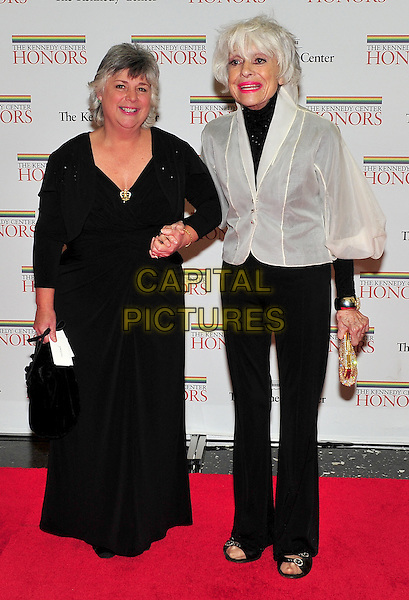 guest & Carol Channing.The formal Artist's Dinner at the United States Department of State in Washington, D.C., USA..December 4th, 2010.full length black dress trousers white jacket holding hands .CAP/ADM/RS.©Ron Sachs/CNP/AdMedia/Capital Pictures.