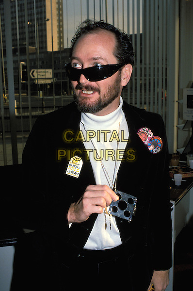 KENNY EVERETT.Ref: 026.www.capitalpictures.com.sales@capitalpictures.com.©Capital Pictures.badge, sunglasses, shades